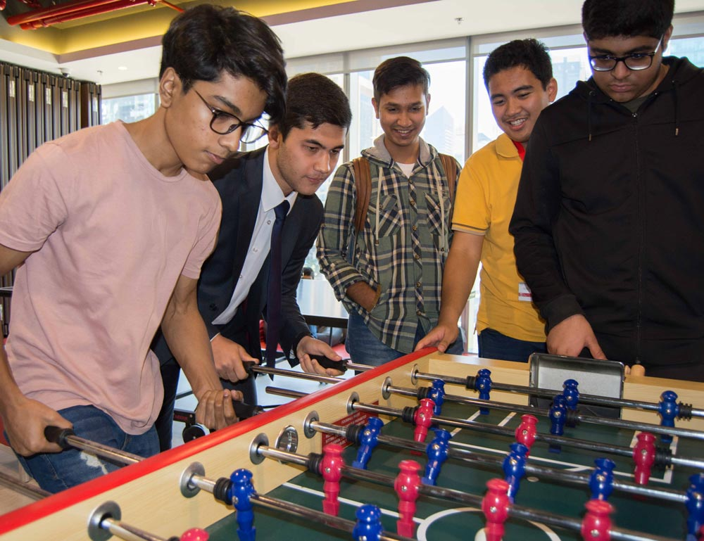 MODUL Students playing foosball
